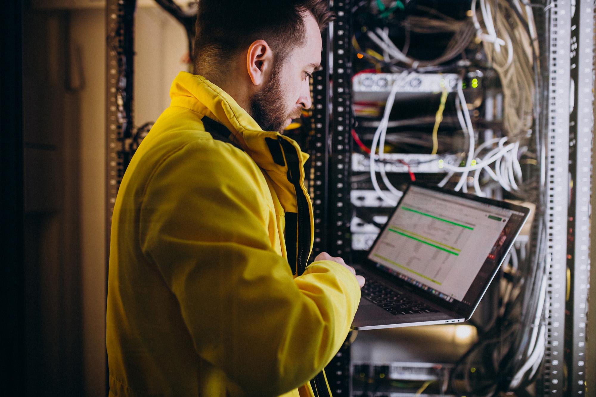 Young man engineer making program analyses