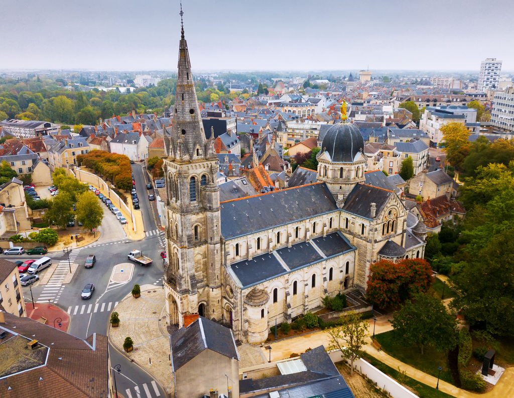Aerial view of picturesque Chateauroux cityscape with Catholic Church of Our Lady, central France
